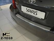 NataNiko Накладка с загибом на бампер Toyota Yaris 2011-2014